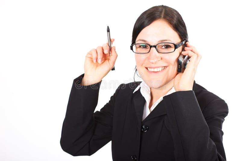 Donna di affari sul telefono delle cellule fotografie stock