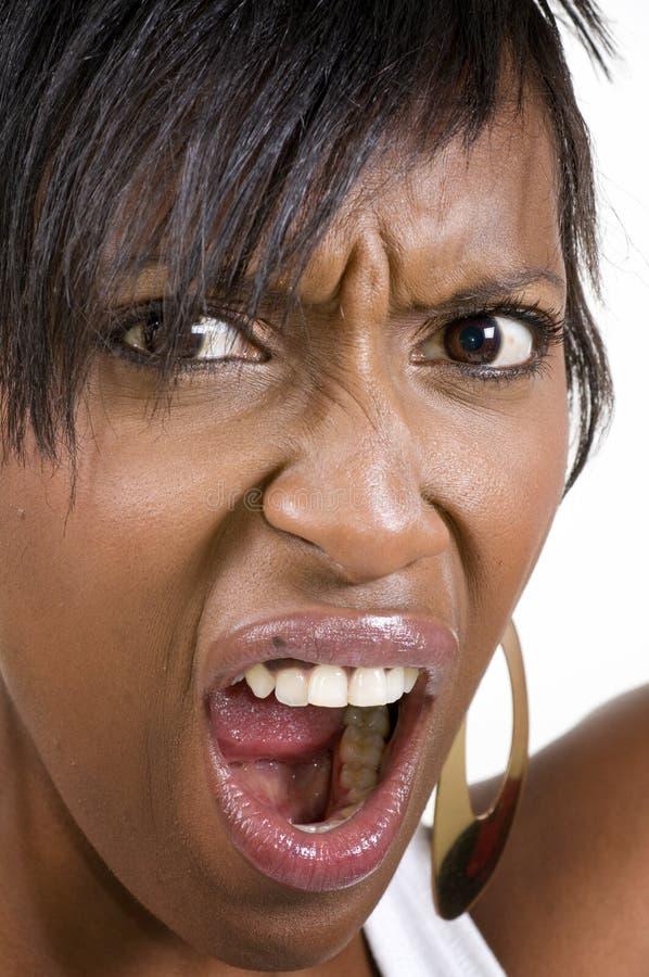 Donna di colore arrabbiata immagine stock