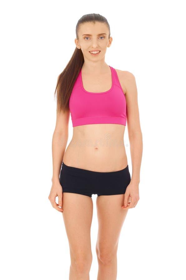 Donna di forma fisica su bianco immagine stock