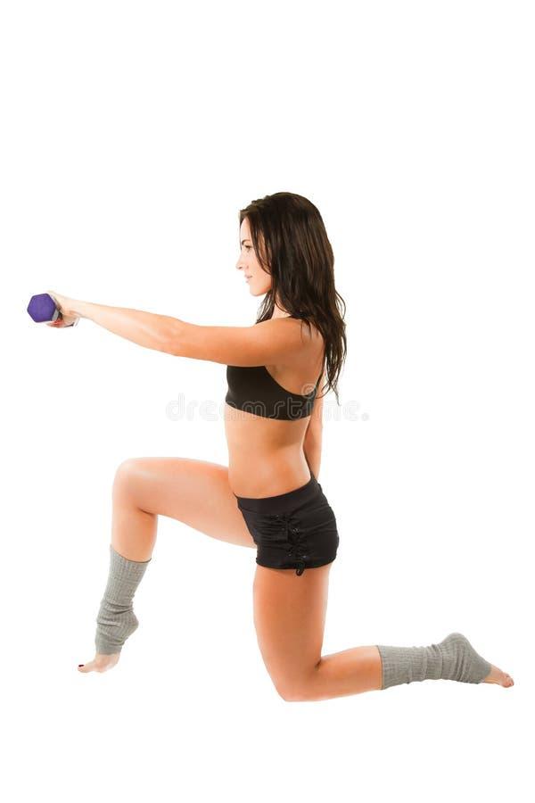 Donna di forma fisica sulla posa dei pilates e di yoga fotografia stock libera da diritti