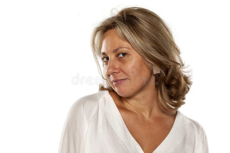 Donna di mezza età sorridente immagine stock