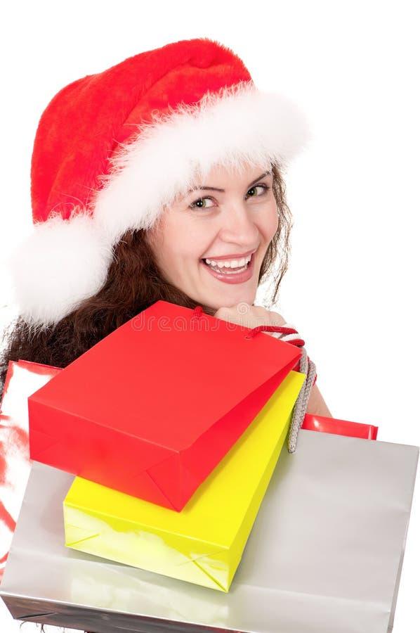 Donna di natale con i sacchetti di acquisto immagini stock