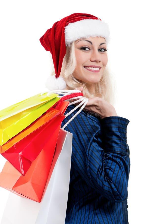 Donna di natale con i sacchetti di acquisto fotografia stock libera da diritti