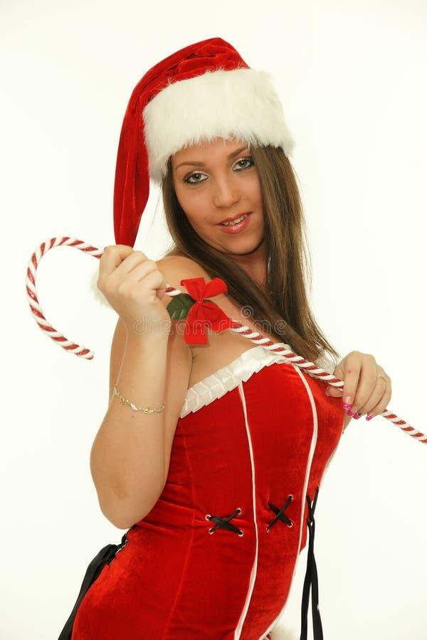 Donna di Natale con il bastoncino di zucchero immagini stock libere da diritti