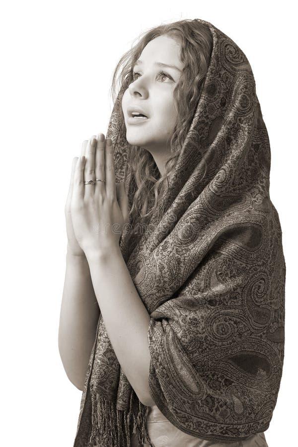 Donna di preghiera fotografie stock