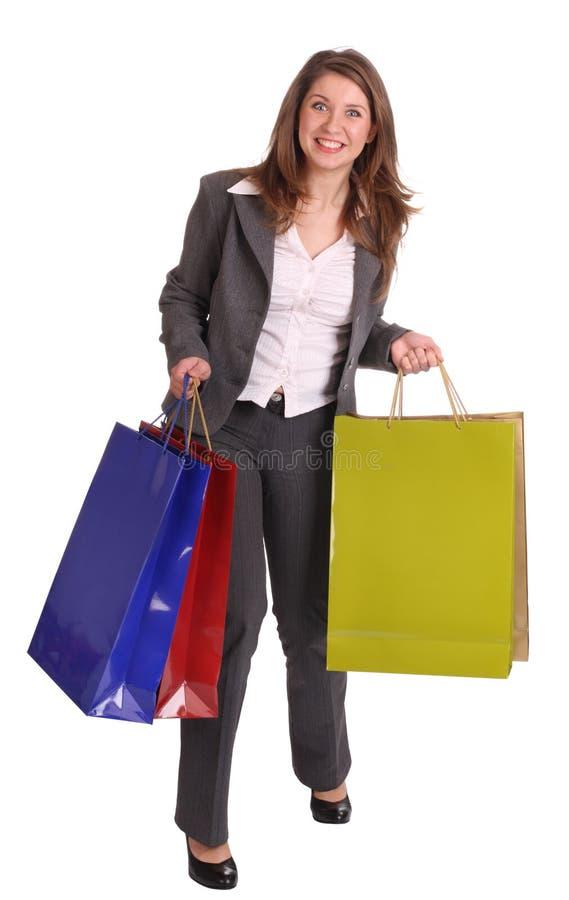 Donna di risata di affari con il sacchetto del regalo. immagini stock