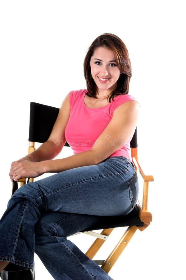 Donna in Direttori Chair fotografia stock libera da diritti