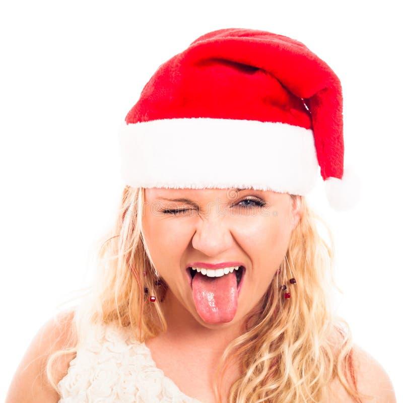 Donna divertente in cappello della Santa di natale fotografia stock