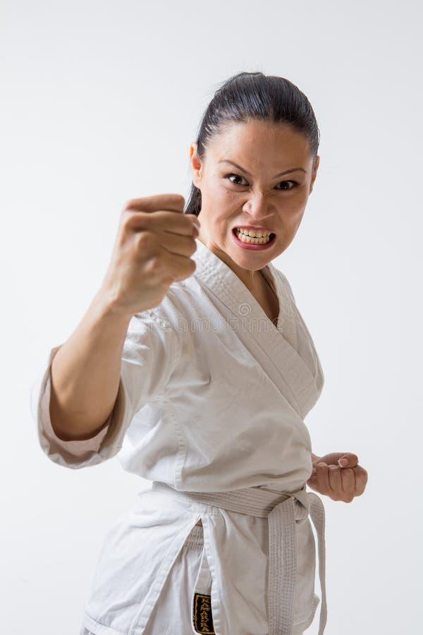 Donna divertente in kimono su bianco fotografie stock