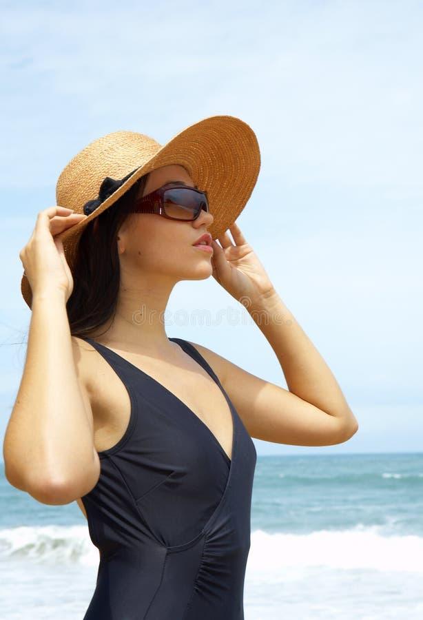 donna e cappello fotografie stock