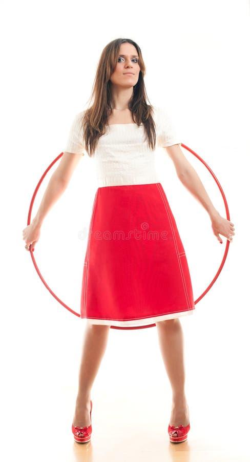 Donna e cerchio rosso immagine stock