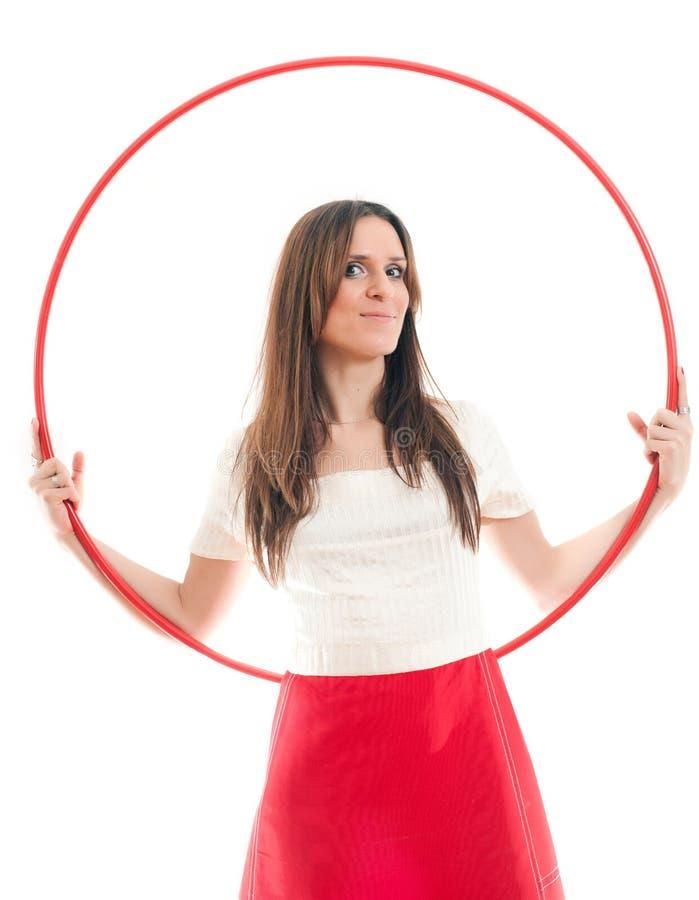Donna e cerchio rosso fotografia stock