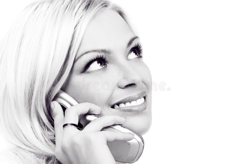Donna e telefono cellulare fotografia stock libera da diritti