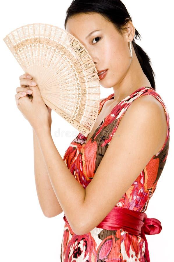 Donna e ventilatore immagini stock