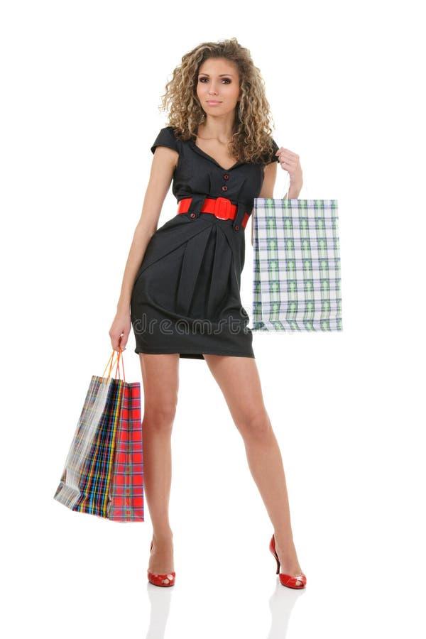 Donna elegante con i sacchetti di acquisto fotografie stock libere da diritti