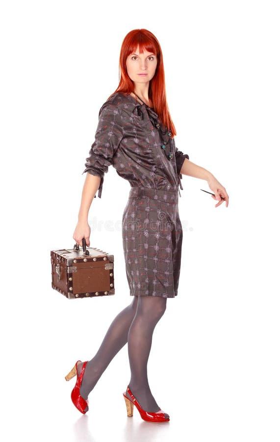 Donna esagerata con la valigia fotografia stock libera da diritti