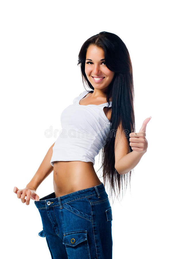 Donna felice che dimostra perdita di peso fotografia stock libera da diritti