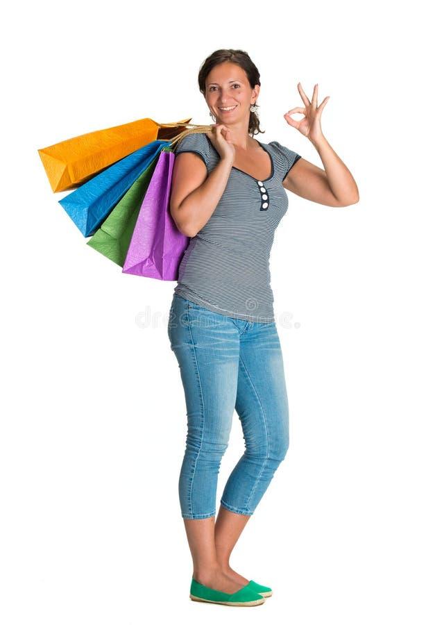 Donna felice con i sacchetti della spesa immagini stock libere da diritti