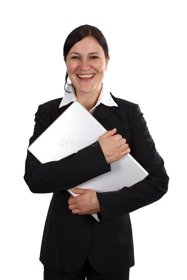 Donna felice con il computer portatile fotografia stock libera da diritti