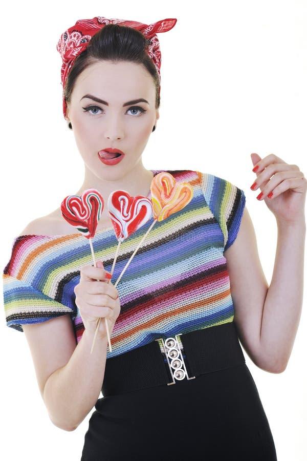 Donna felice con il lollipop isolato su bianco fotografia stock