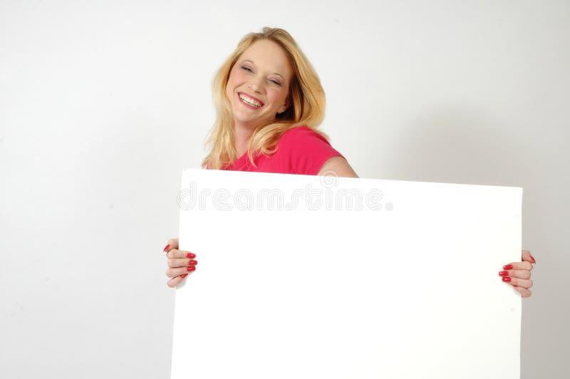 Donna felice con il segno fotografia stock
