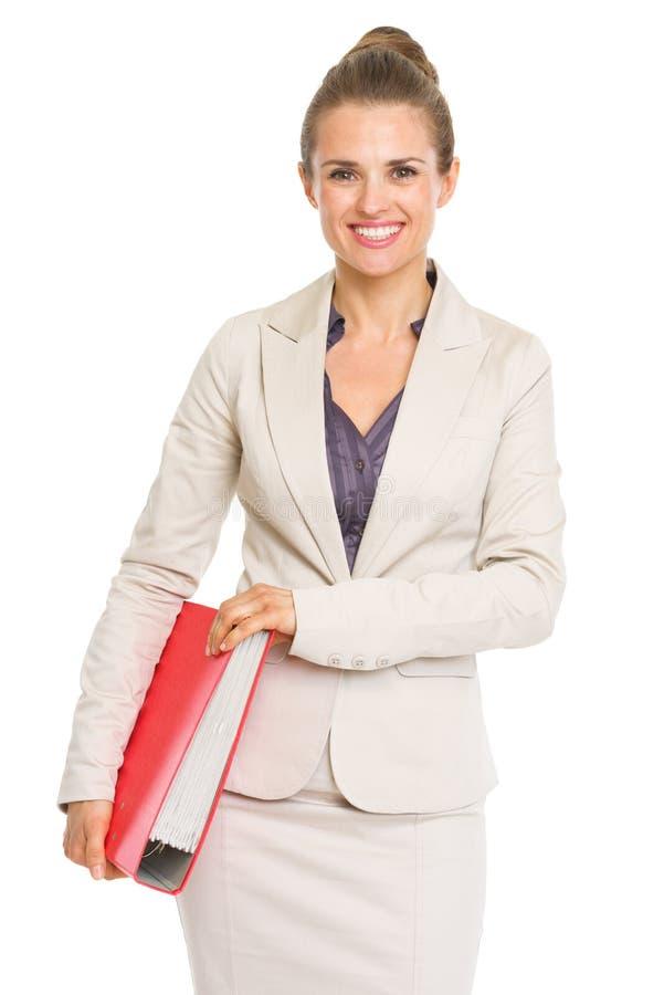 Donna felice di affari con la cartella fotografia stock