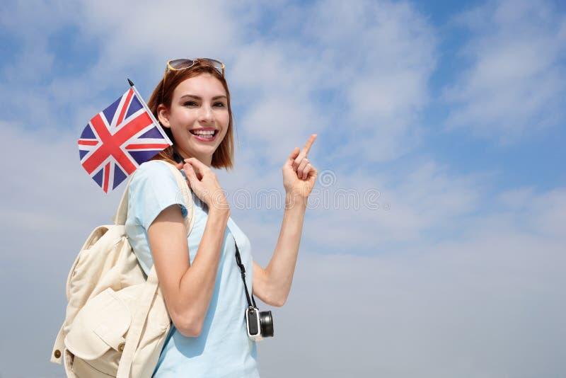 Donna felice di viaggio dei giovani immagine stock