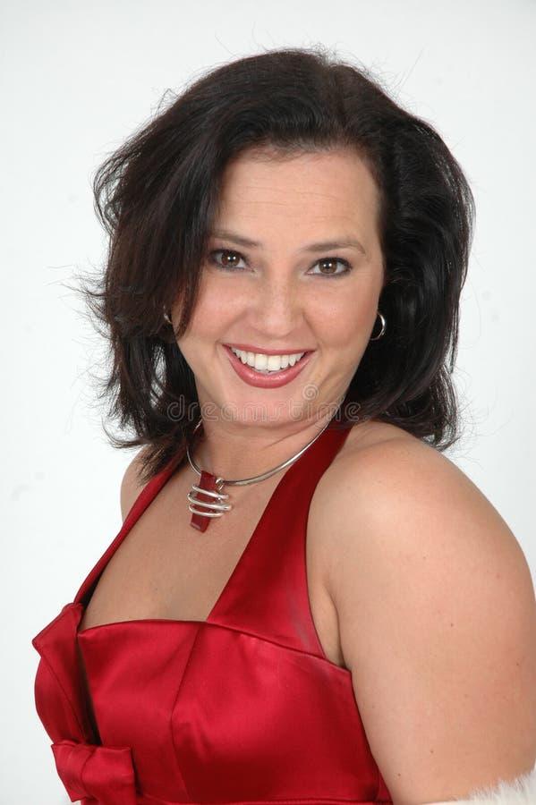 Donna felice nel colore rosso immagine stock