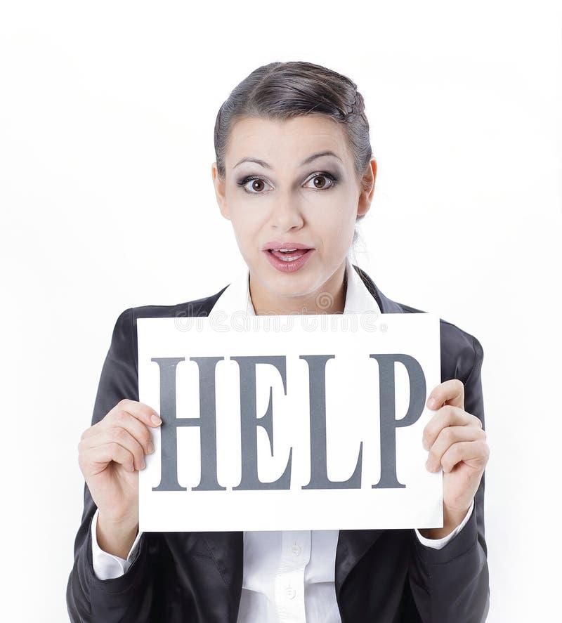 Donna frustrata di affari che mostra carta, scrivente aiuto immagini stock