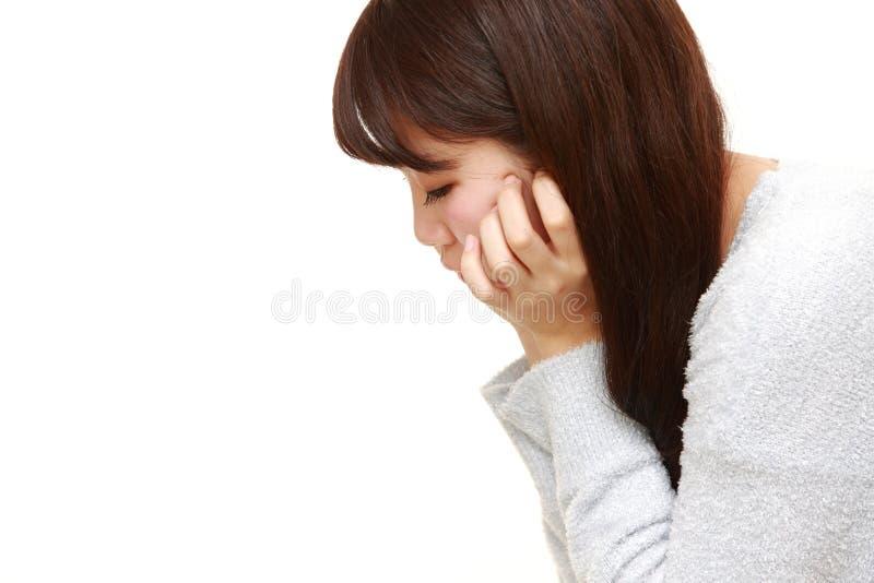 Donna giapponese giovane depressa immagini stock
