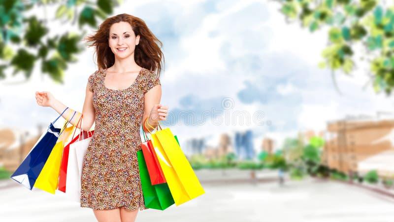 Donna giovane con i sacchetti di acquisto fotografie stock libere da diritti