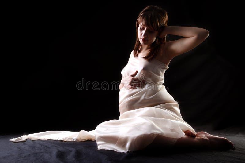 Donna in grande aspettativa fotografia stock