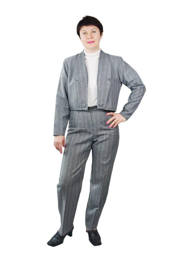Donna graziosa che indossa vestito grigio fotografia stock