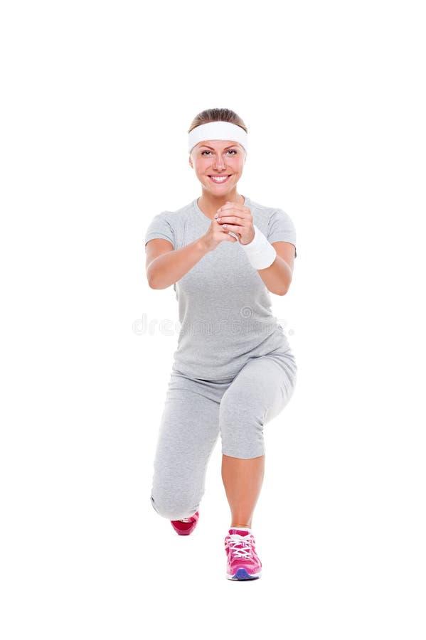 Donna graziosa di smiley che fa aerobics immagine stock