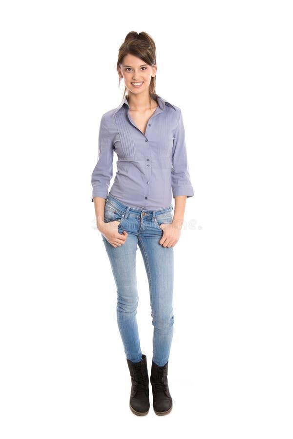 Donna graziosa isolata in blue jeans e nella statura completa. immagine stock