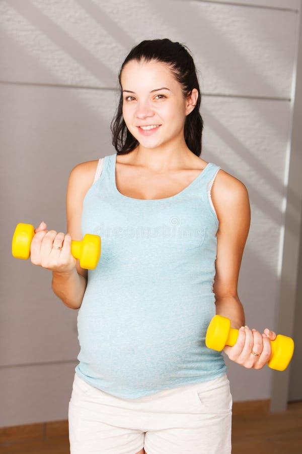 donna incinta attiva fotografie stock