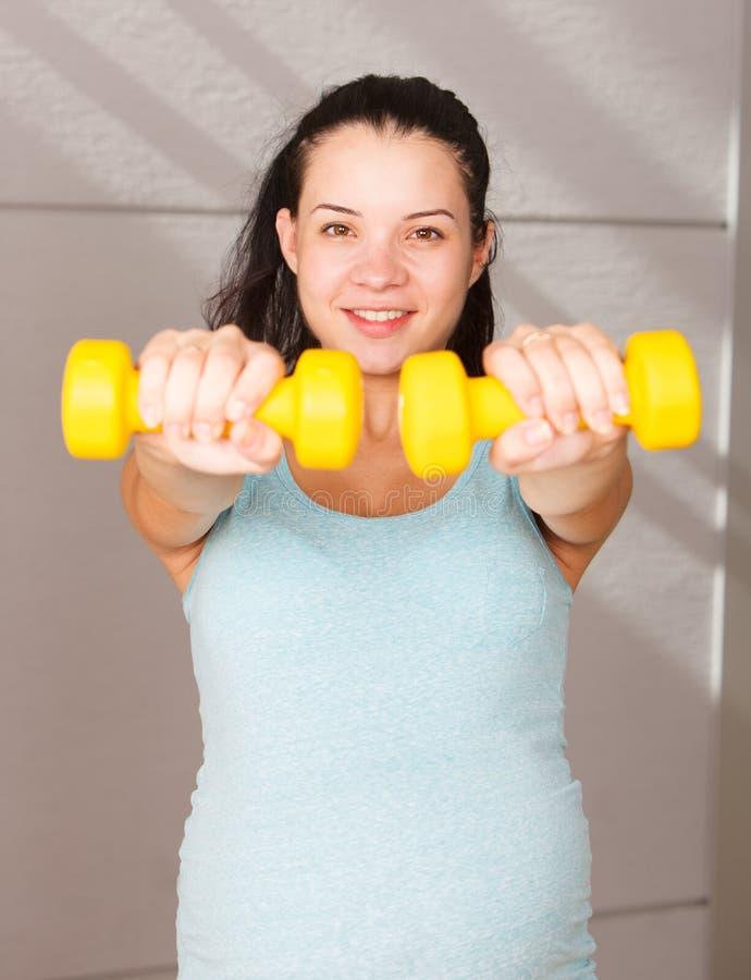 donna incinta attiva fotografia stock