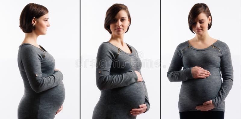 Donna incinta che tocca la sua pancia fotografie stock