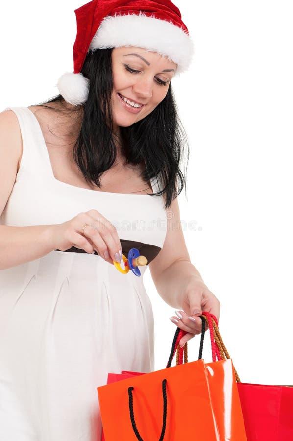 Donna incinta con i sacchetti di acquisto immagine stock libera da diritti