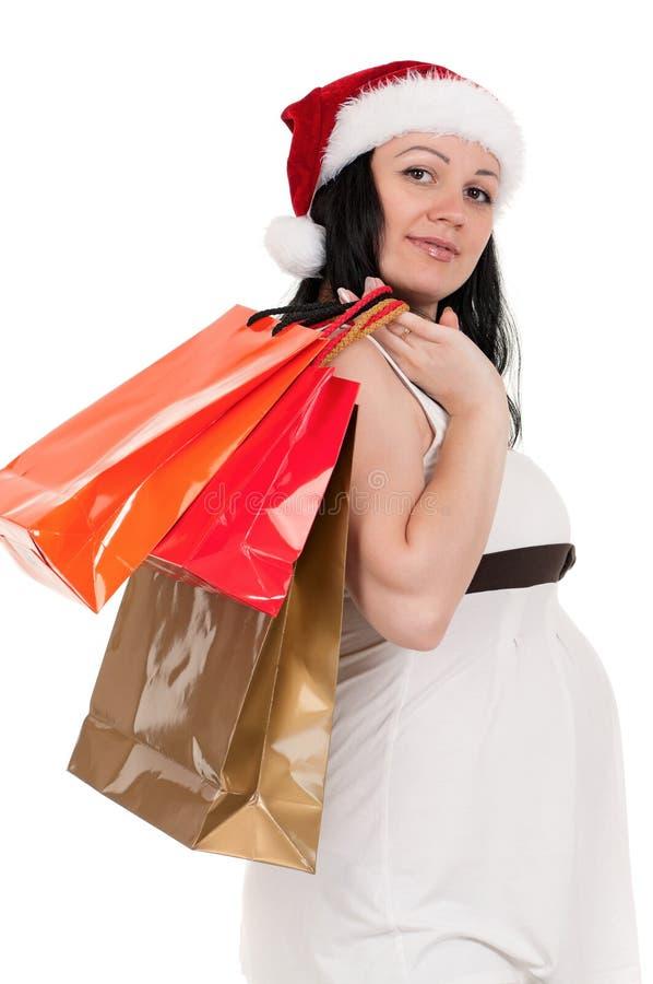 Donna incinta con i sacchetti di acquisto fotografia stock libera da diritti