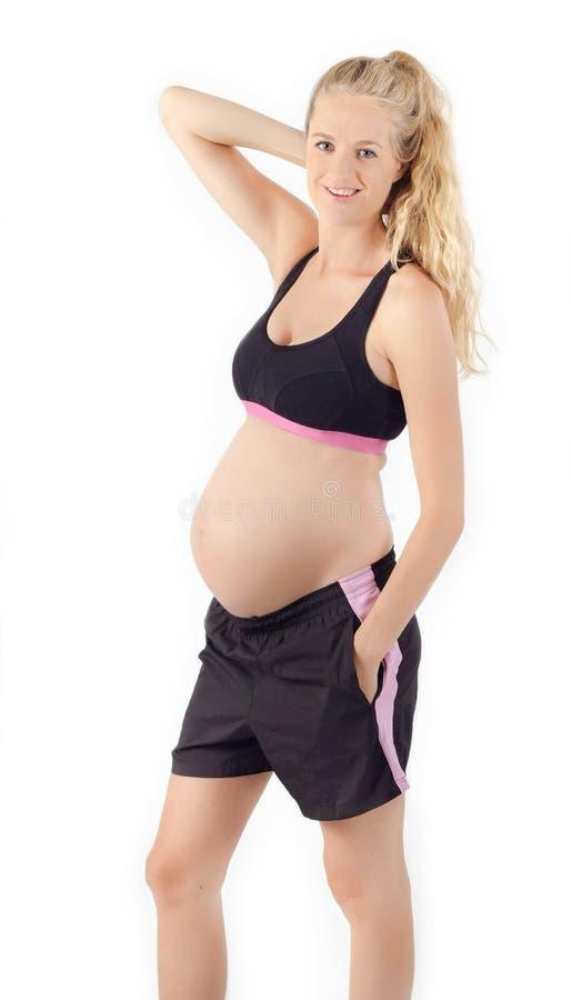 Donna incinta di forma fisica immagini stock libere da diritti