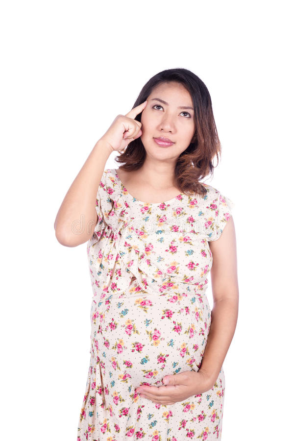 Donna incinta nel pensiero del vestito isolato su bianco fotografia stock libera da diritti