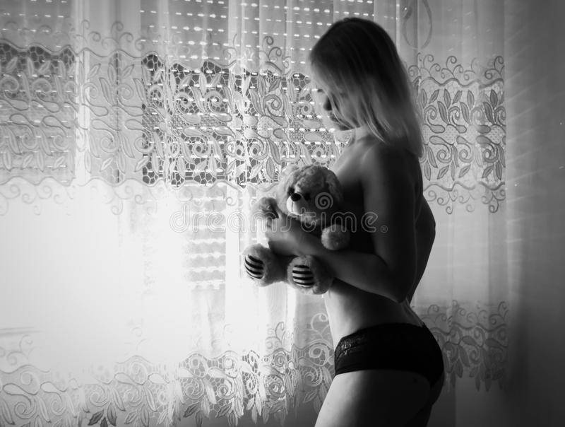 Donna infantile fotografia stock