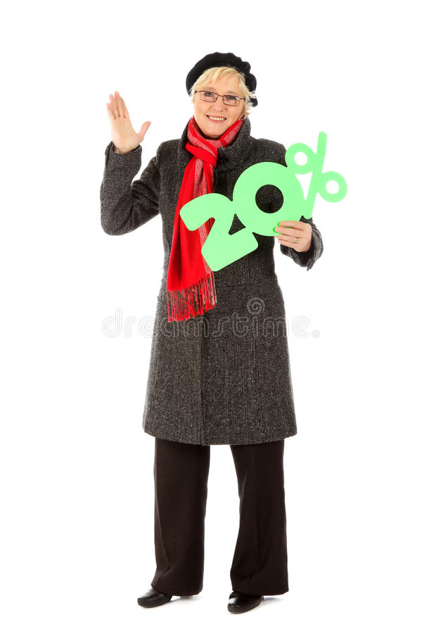 Donna invecchiata centrale, segno di sconto di venti per cento immagini stock libere da diritti
