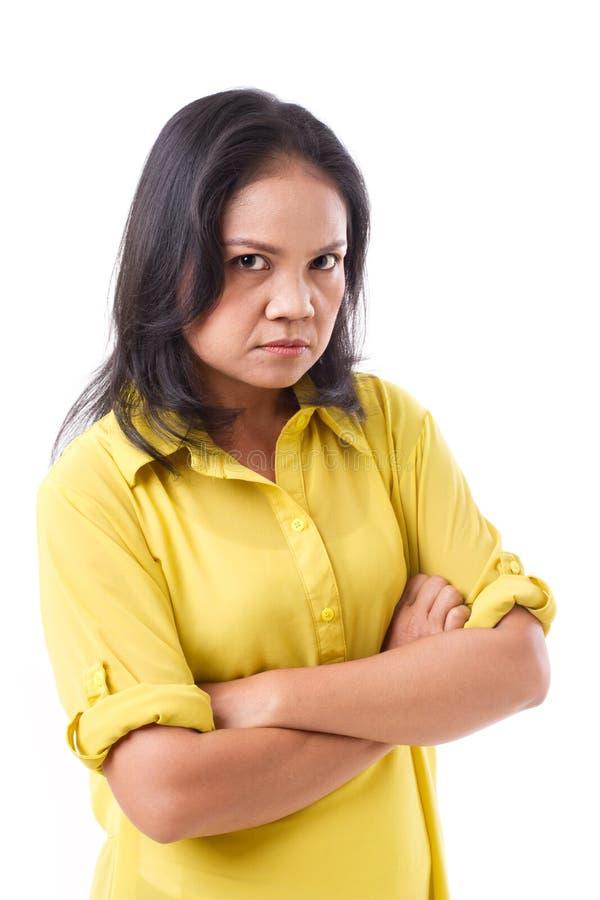 Donna invecchiata mezzo infelice arrabbiato di ribaltamento immagine stock