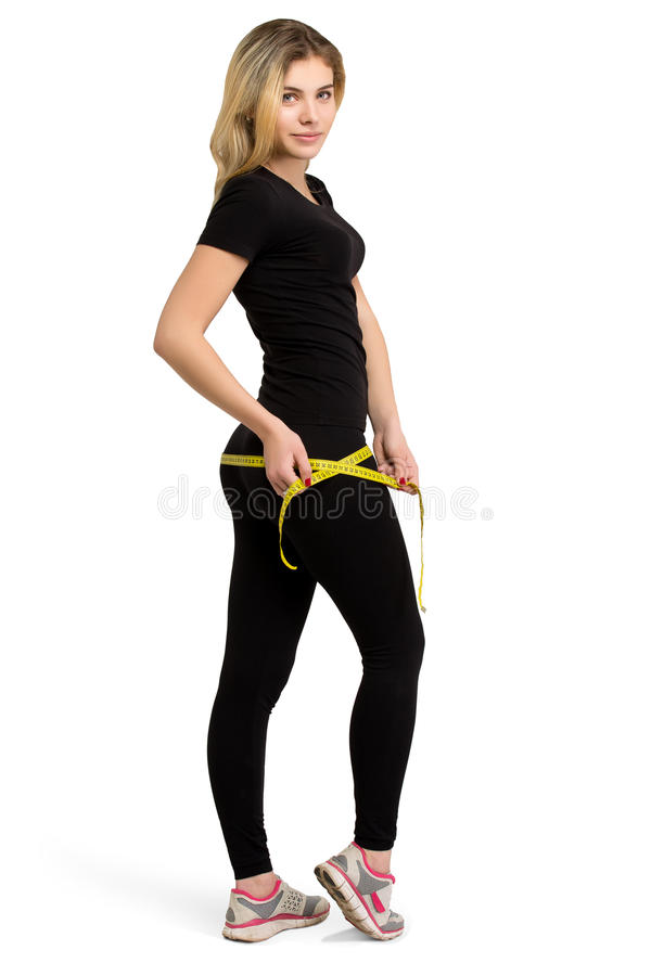 Donna isolata esile, perdita di peso con nastro adesivo di misurazione fotografia stock