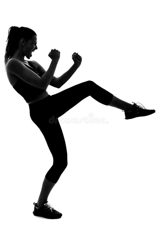 Donna, istruttore personale, abiti sportivi neri d'uso fotografia stock libera da diritti