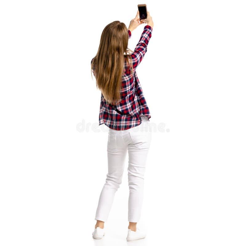 Donna in jeans bianchi e camicia che fanno lo smartphone del selfie immagine stock libera da diritti