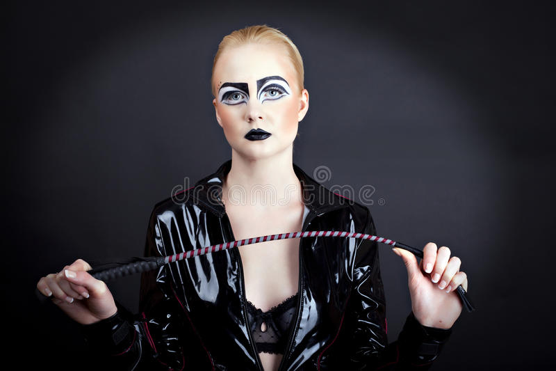 Donna in lattice fotografie stock