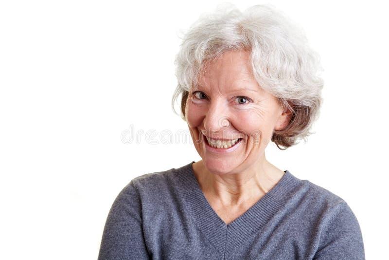 Donna maggiore con il grin sul suo fronte immagine stock libera da diritti